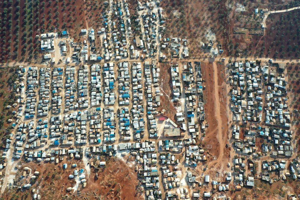 An aerial picture shows camps for displaced Syrians in the village of Killi, near Bab al-Hawa by the border with Turkey, in the northwestern Idlib province, on January 9, 2021. (Photo by Omar HAJ KADOUR / AFP) (Photo by OMAR HAJ KADOUR/AFP via Getty Images)
