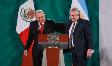 MEXICO CITY, MEXICO - FEBRUARY 23:  President of Mexico Andres Manuel Lopez Obrador and President of Argentina Alberto Fernandez greet during a press conference at Palacio Nacional on February 23, 2021 in Mexico City, Mexico. (Photo by Hector Vivas/Getty Images)