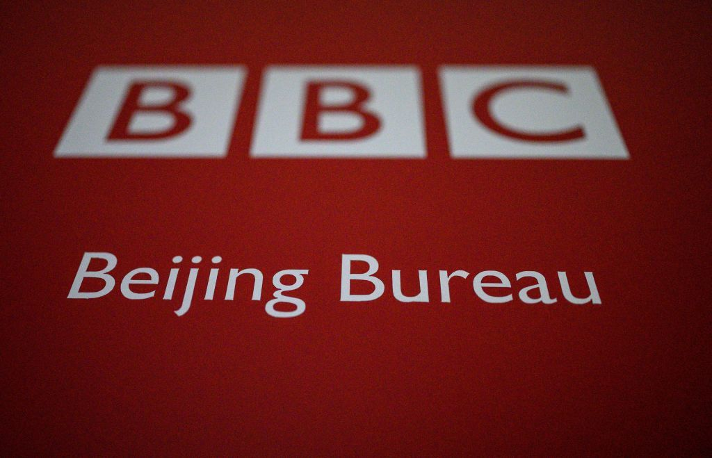 This photo shows the BBC logo at their Beijing bureau office on February 12, 2021. - China's broadcasting regulator on February 11, 2021 banned BBC World News, accusing it of flouting guidelines after a controversial report on its treatment of the country's Uighur minority. The decision came just days after Britain's own regulator revoked the licence of Chinese broadcaster CGTN for breaking UK law on state-backed ownership, and provoked angry accusations of censorship from London. (Photo by NOEL CELIS / AFP) (Photo by NOEL CELIS/AFP via Getty Images)