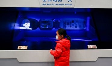 A child wearing a face mask visits China Science and Technology Museum in Beijing on December 27, 2020. (Photo by WANG Zhao / AFP) (Photo by WANG ZHAO/AFP via Getty Images)