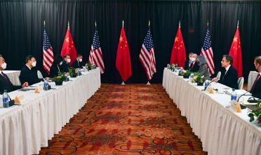 """TOPSHOT - US Secretary of State Antony Blinken (2nd R), joined by National Security Advisor Jake Sullivan (R), speaks while facing Yang Jiechi (2nd L), director of the Central Foreign Affairs Commission Office, and Wang Yi (L), China's Foreign Minister at the opening session of US-China talks at the Captain Cook Hotel in Anchorage, Alaska on March 18, 2021. - China's actions """"threaten the rules-based order that maintains global stability,"""" US Secretary of State Antony Blinken said Thursday at the opening of a two-day meeting with Chinese counterparts in Alaska. (Photo by Frederic J. BROWN / POOL / AFP) (Photo by FREDERIC J. BROWN/POOL/AFP via Getty Images)"""
