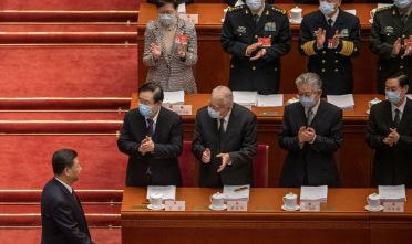 BEIJING, CHINA - MARCH 05: President Xi Jinping (L) is applauded by members of the government, including Hong Kong Chief Executive Carrie Lam, left top row, as he arrives at the opening session of the National People's Congress at the Great Hall of the People on March 5, 2021 in Beijing, China. The annual political gatherings of the National Peoples Congress and the Chinese People's Political Consultative Conference, known as the Two Sessions, brings together China's leadership and lawmakers to set the blueprint for the coming year. It is considered the most important event on the governments calendar and offers a rare glimpse at what President Xi Jinping and top officials see as priorities. With the pandemic largely under control in China, discussions this year are expected to signal Beijings intentions around technology competition, control over Hong Kong, and strategic threats posed by Western countries including the United States. The political meetings, held at the Great Hall of the People at the edge of Tiananmen Square in central Beijing, can typically last for up to two weeks. (Photo by Kevin Frayer/Getty Images)