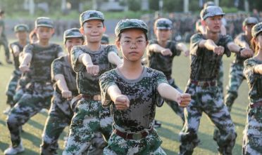 This photo taken on August 25, 2020 shows high school students taking part in a military education and training session ahead of the new semester in Yongzhou in China's central Hunan province. (Photo by STR / AFP) / China OUT (Photo by STR/AFP via Getty Images)