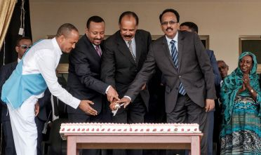 Eritrea's President Isaias Afwerki (2ndR), Ethiopia's Prime Minister Abiy Ahmed (2ndL) and Somalia's President Mohamed Abdullahi Mohamed (R) cut a ceremonial cake together during the inauguration of the Tibebe Ghion Specialized Hospital in Bahir Dar, northern Ethiopia, on November 10, 2018. - Presidents of Somalia and Eritrea met Ethiopian Prime Minister Abiy Ahmed on November 9, 2018 to cement regional economic ties as relations warm between the once-rival nations. (Photo by EDUARDO SOTERAS / AFP)        (Photo credit should read EDUARDO SOTERAS/AFP via Getty Images)