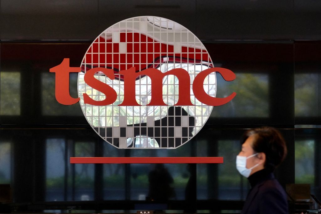 A man walks past a company logo at the headquarters of the world's largest semiconductor maker TSMC in Hsinchu on January 29, 2021. (Photo by Sam Yeh / AFP) (Photo by SAM YEH/AFP via Getty Images)