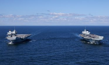 HMS Prince of Wales and HMS Queen Elizabeth pictured at sea for the first time.