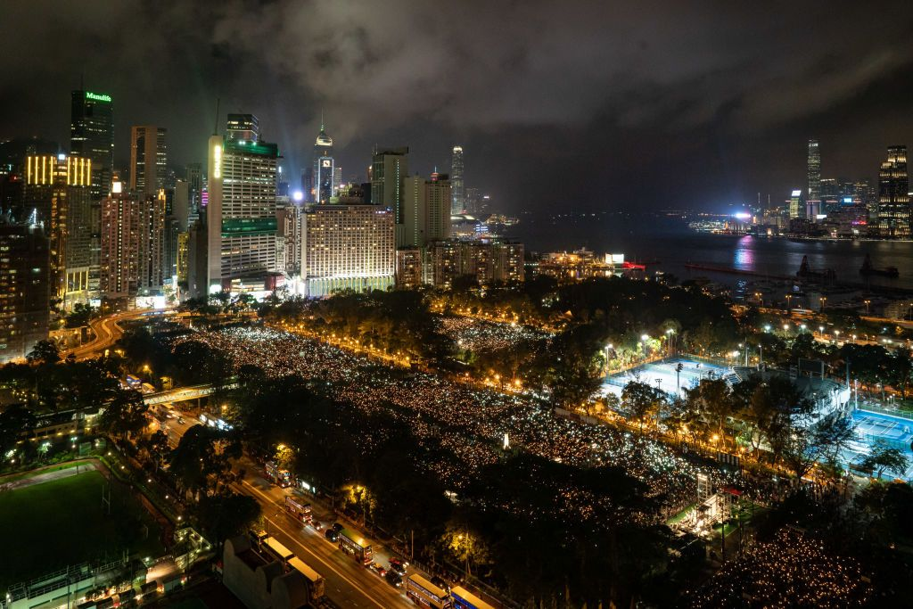 HONG KONG, HONG KONG - JUNE 04: People hold candles as they take part in a candlelight vigil at Victoria Park on June 4, 2019 in Hong Kong, China. As many as 180,000 people were expected to attend a candlelight vigil in Hong Kong on Tuesday on the 30th anniversary of the Tiananmen Square massacre. Commemorations took place in cities around the world on June 4 to remember those who died when Chinese troops cracked down on pro-democracy protesters. Thirty years ago, the People's Liberation Army opened fire and killed from hundreds to thousands of protesters in Beijing after hundreds of thousands of students and workers gathered in Tiananmen Square for weeks to call for greater political freedom. No-one knows for sure how many people were killed as China continues to censor any coverage or discussion of the event that takes place during the anniversary.  (Photo by Anthony Kwan/Getty Images)