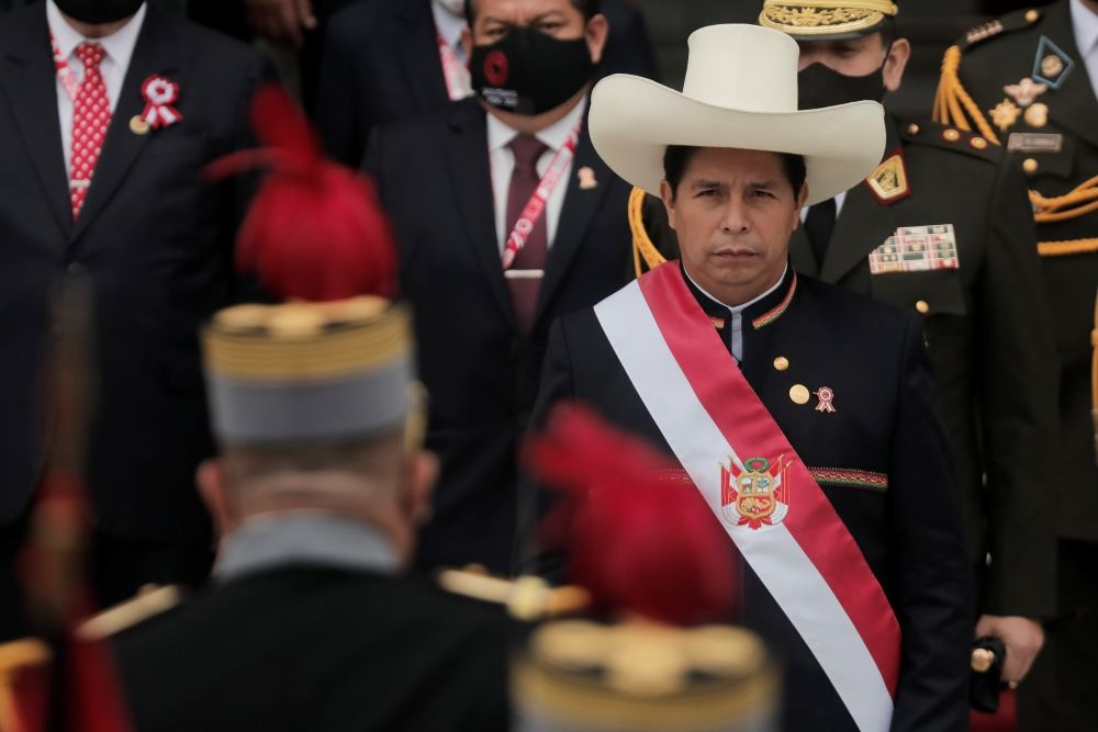 LIMA, PERU - JULY 28: President of Peru Pedro Castillo walks out of Congress wearing the presidential sash after the presidential inauguration on July 28, 2021 in Lima, Peru. Castillo of Peru Libre defeated Keiko Fujimori of Fuerza Popular by a slight difference in the runoff on June 6. Peruvians are also celebrating the 200th anniversary of their independence. (Photo by Getty Images/Getty Images)