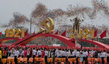 BEIJING, CHINA - JULY 01: The crowd looks on as balloons are released at a a ceremony marking the 100th anniversary of the Communist Party on July 1, 2021 at Tiananmen Square in Beijing, China. (Photo by Kevin Frayer/Getty Images)