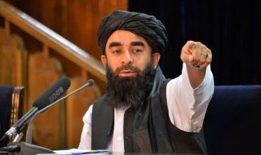 TOPSHOT - Taliban spokesperson Zabihullah Mujahid gestures during a press conference in Kabul on August 24, 2021 after the Taliban stunning takeover of Afghanistan. (Photo by Hoshang Hashimi / AFP) (Photo by HOSHANG HASHIMI/AFP via Getty Images)