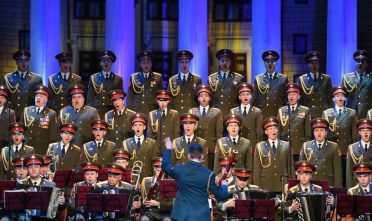 The Red Army Choir performs during their first concert since many of its members perished in a plane crash, in Moscow on February 16, 2017. The Russian military plane carrying Chief Conductor and Artistic Director of Alexandrov Song and Dance Ensemble (known also as Red Army Choir) crashed on its way to Syria on December 25, with 92 onboard, which included 64 members of Red Army Choir heading to celebrate the New Year with troops. / AFP / Natalia KOLESNIKOVA        (Photo credit should read NATALIA KOLESNIKOVA/AFP via Getty Images)