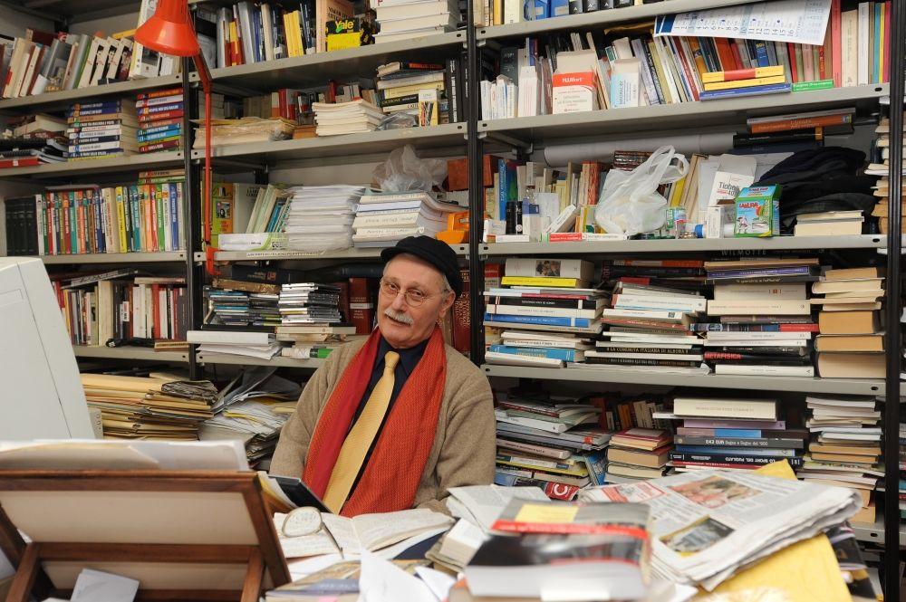 Latina, Italy. Italian writer Antonio Pennacchi is shown among books in his house at Latina, not far from Rome, November 16 2010 (Photo by Vittoriano Rastelli/Corbis via Getty Images)