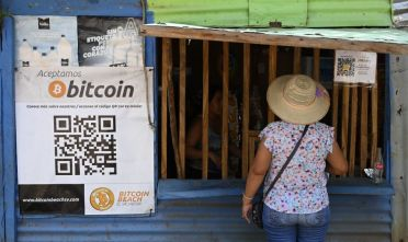 TOPSHOT - A woman buys in a store that accepts bitcoins in El Zonte, La Libertad, El Salvador on September 4, 2021. - The Congress of El Salvador approved in June a law that will make bitcoin legal tender in the country from September 7, with the aim of boosting its economy although analysts warn of a negative impact. (Photo by MARVIN RECINOS / AFP) (Photo by MARVIN RECINOS/AFP via Getty Images)