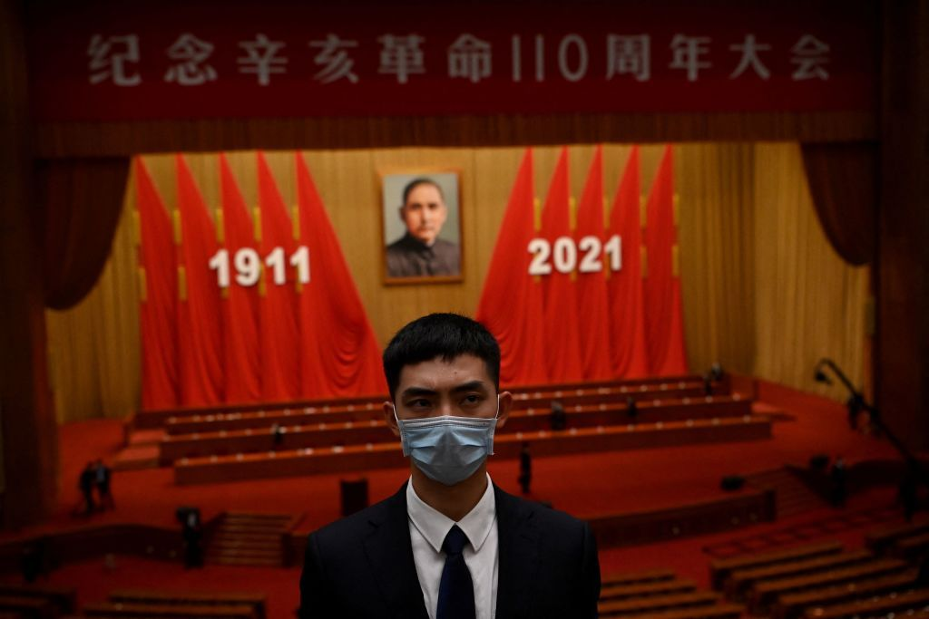 A member of security stands guard after the commemoration of the 110th anniversary of the Xinhai Revolution which overthrew the Qing Dynasty and led to the founding of the Republic of China, at the Great Hall of the People in Beijing on October 9, 2021. (Photo by Noel Celis / AFP) (Photo by NOEL CELIS/AFP via Getty Images)