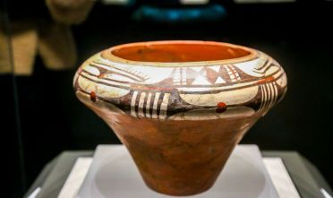 ZHENGZHOU, CHINA - FEBRUARY 18: Painted pottery bowl with white coating, which was excavated at the Dahe Cun Site of Yangshao Neolithic Culture (circa 7,000-5,000 BCE), is on display during the permanent exhibition titled 'A great civilization rises with capitals established in the central plain' at Henan Museum on February 18, 2021 in Zhengzhou, Henan Province of China. (Photo by VCG/VCG via Getty Images)