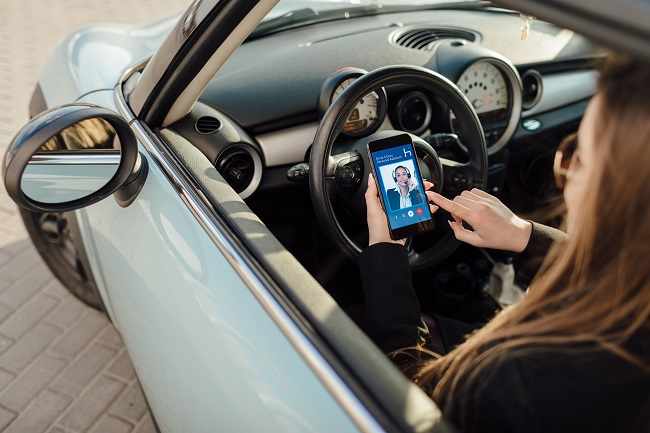 Woman,In,Car.,Girl,Using,Smartphone,App,To,Pay,For