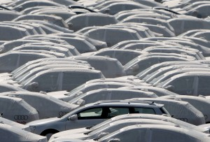 FILE PHOTO: New VW cars covered with protective covers on a transport ship at Emden harbour