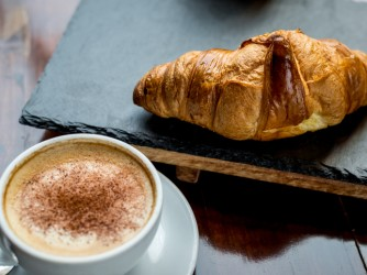 Cappuccino and croissant in the cafe