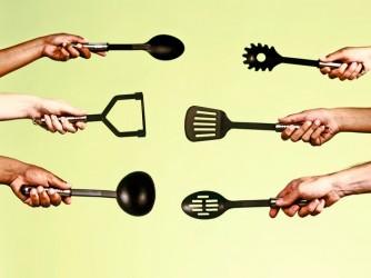Duelling chefs challenge each other with kitchen utensils