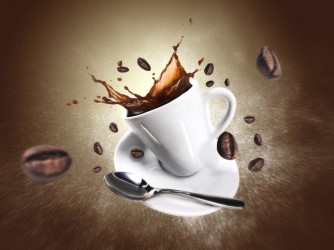 Explosion of coffee with a cup and beans