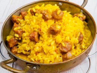 risotto with homemade sausage and saffron in little old pan.