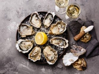 Opened Oysters Fines de Claire and white wine