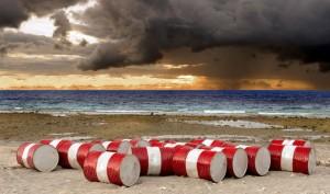 14264652 - lot of oil barrels on a seashore  environment pollution