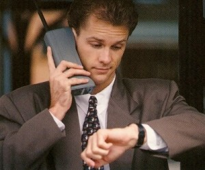 An-80s-era-yuppy-with-one-of-the-first-cell-phones