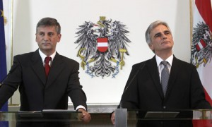 Austrian Vice Chancellor Spindelegger and Chancellor Faymann listen during a news conference after a cabinet meeting in Vienna
