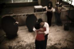 """Teheran, giugno 2009. """"È l'ultima foto del reportage dai tetti, quella che mi sta più dentro il cuore. Un abbraccio di tenerezza fra due fratelli, entrambi tornati per le elezioni, lei dal Canada lui dagli Usa, speravano di riuscire a cambiare qualcosa, invece no. Un abbraccio di delusione, di rabbia. È l'ultima foto del servizio""""."""