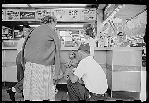 Rizzuto[People gathered at soda fountain, New York, New York]