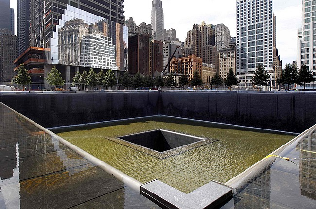 A general view shows the south pool waterfall as work continues on the National September 11 Memorial and Museum at the World Trade Center site in New York
