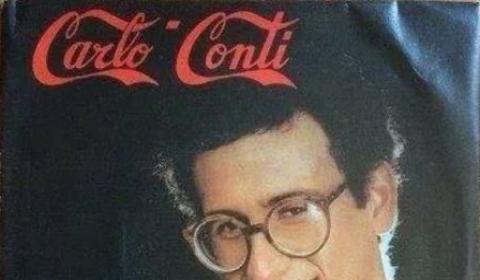"""Il dj Carlo Conti crea il suo marchio """"rubando"""" i caratteri alla Coca Cola"""
