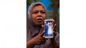 Jamaliah mostra la foto di Jannah a 4 anni