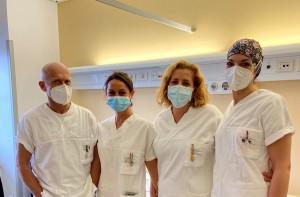 Personale sanitario del Policlinico di Modena con la manina appuntata al camice