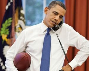 esq-barack-obama-football-080311-xlg