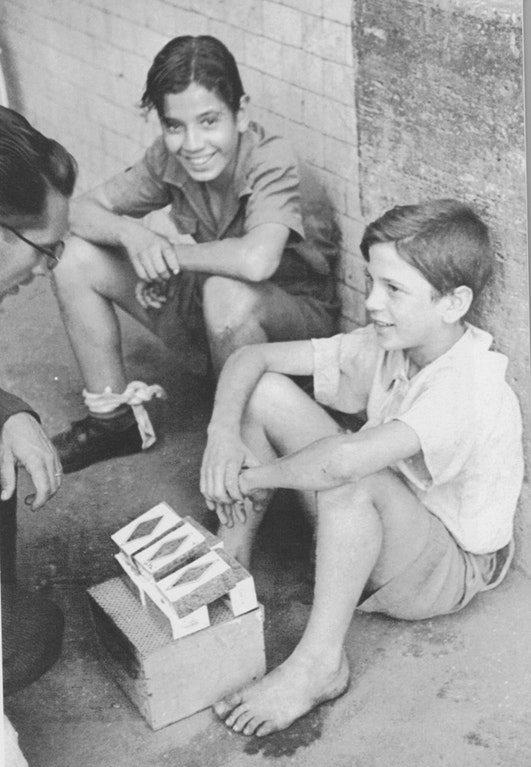 Kids in the 1940s selling contraband cigarettes