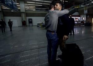 Glenn Greenwald (front L) embraces his partner David Miranda