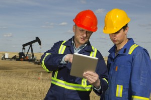 Oil Workers with Mobile Tablet (800x533)