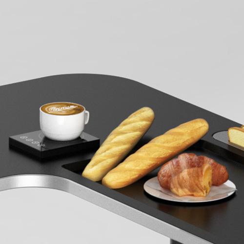 L'area colazione di The Omnidesk di Viking comprende tostapane, dispositivo scaldavivande, macchina del caffè e sottotazza con riscaldamento a induzione