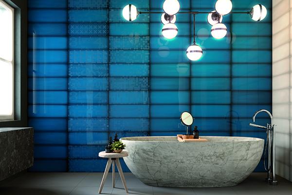 "La collezione <em>Slide</em> di <a href=""http://www.irisceramica.it/"">Iris Ceramica</a> si ispira al vetro:grazie alla sua lucidafinitura prendono vita suggestivigiochi di luce"