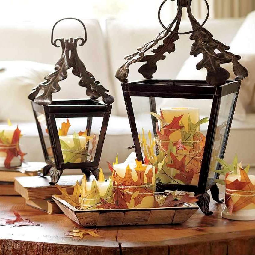 Lanterne decorate con foglie secche