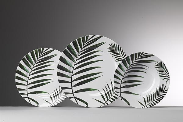 Piatti di melamina decorate da foglie verdeggianti di  kenzia firmati Mario Luca Giusti