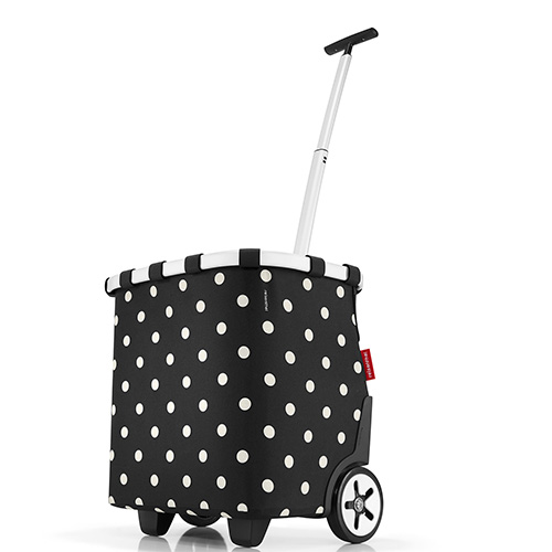"""Un carrello per trasportare tutto il necessario senza fatica, come <em>Carrycruiser</em>di <a href=""""https://www.reisenthel.com"""">Reisenthel</a>,qui nella nuova versione con motivo """"mixed dots"""" (139,95 euro)"""