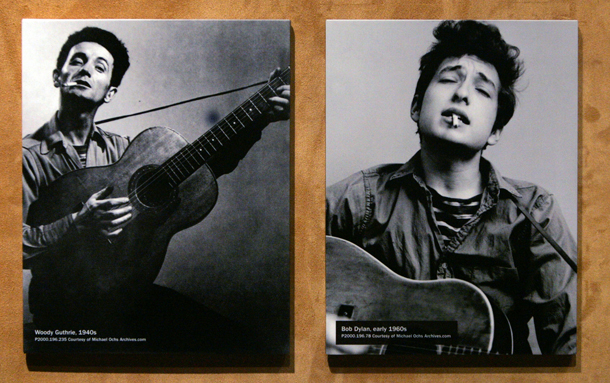 """** ADVANCE FOR WEEKEND EDITIONS NOV. 20-21 ** A photo of Woody Guthrie, from the 1940's, left, is displayed next to one of Bob Dylan, from the 1960's,   as part of a new display about Dylan at the Experience Music Project Wednesday, Nov. 17, 2004, at the museum in Seattle. The first major museum exhibit dedicated to Dylan's work, """"Bob Dylan's American Journey, 1956-1966,"""" opens there Saturday, Nov. 20. Dylan was greatly influenced by Guthrie and in many ways patterned himself after him. (AP Photo/ElaineThompson)"""