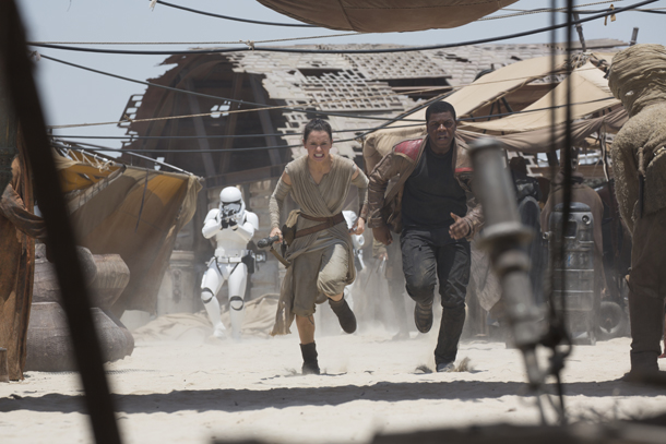 Star Wars: The Force Awakens L to R: Rey (Daisy Ridley) and Finn (John Boyega) Ph: David James ©Lucasfilm 2015
