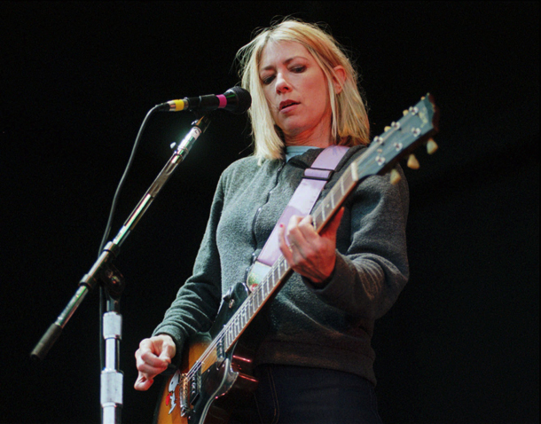 "Kim Gordon, bassist for the band ""Sonic Youth,"" performs in Greenwood Village, Colo., May 25, 1995. (AP Photo/Joe Mahoney)"